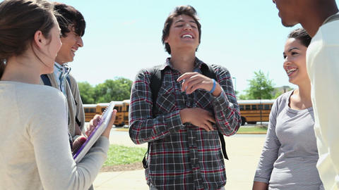 High school students talking and laughing outside Stock Video Footage