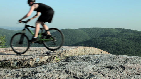 Male cyclist riding on rocks Stock Video Footage