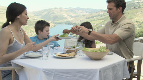 Family sitting at table on holiday Stock Video Footage