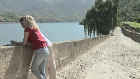 Couple walking by douro river and looking at view Stock Video Footage