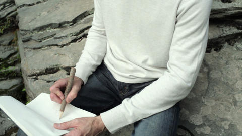 Senior man drawing outdoors Stock Video Footage