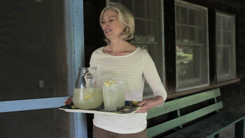 Mature woman with tray of homemade lemonade Stock Video Footage