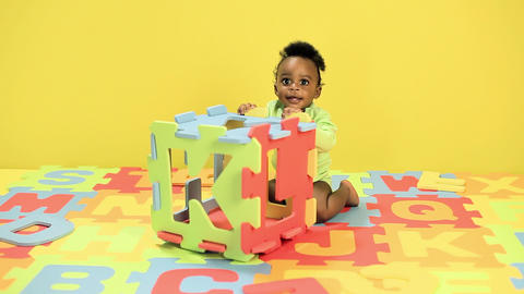 Baby boy playing with toy alphabet letters Stock Video Footage