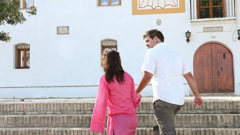 Young couple walking up steps Stock Video Footage