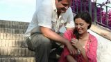 Young couple sitting on steps, man giving woman flower Footage