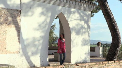 Young woman leaning on wall on holiday Stock Video Footage