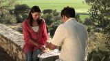 Young couple sitting on wall with wine Footage