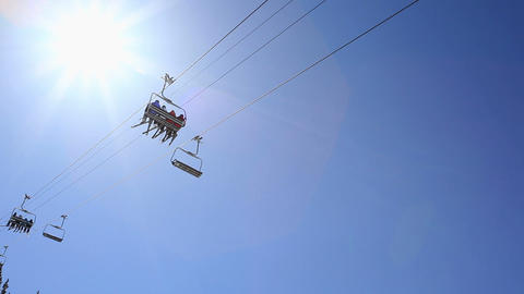 Low angle view of ski lift and sky with sunlight Stock Video Footage