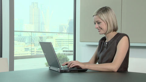 Businesswoman typing on laptop computer Stock Video Footage