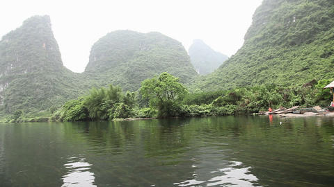 China, yangshuo, view from boat on yulong river Live Action