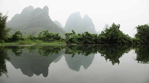 China, yangshuo, yulong river and landscape viewed from boat Stock Video Footage