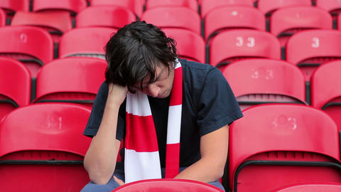 Football fan in empty stadium looking depressed Stock Video Footage