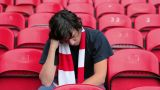 Football fan in empty stadium looking depressed Footage