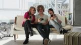 Three teenage friends looking at smartphones Footage