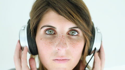Teenage girl wearing headphones and listening to music Stock Video Footage