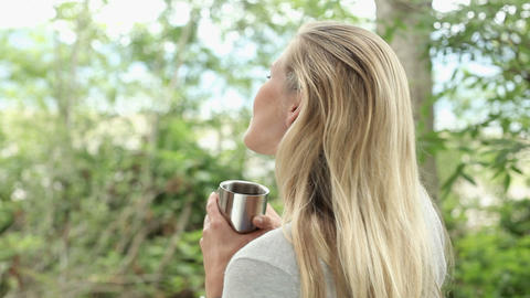 Mid adult woman drinking hot drink Stock Video Footage