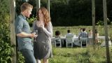 Young couple away from group at farm dinner party Footage
