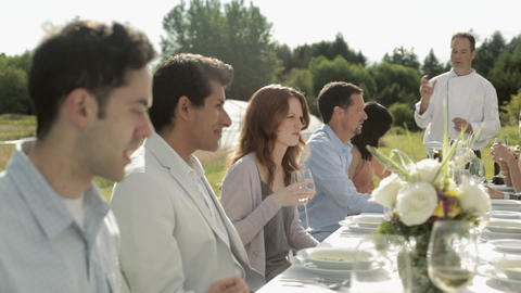 People at dinner party on a farm Stock Video Footage