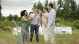 Four People Toasting With Wine Glasses At Farm Dinner Party stock footage