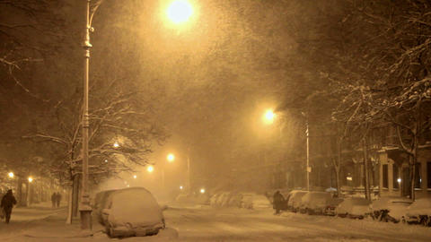 Night time view of a street in the snow, illuminated by... Stock Video Footage