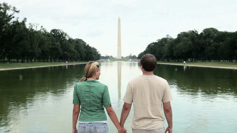 Rear view of young couple by washington monument Stock Video Footage