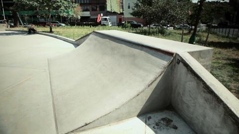 Skateboarder on quarter pipe at skate park Stock Video Footage