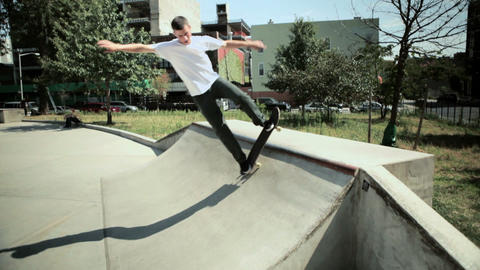Skateboarder on quarter pipe at skate park Stock Video Footage
