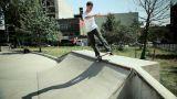 Skateboarder on quarter pipe at skate park Footage