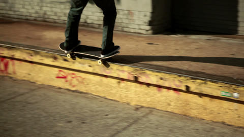Skateboarder doing trick on sidewalk Stock Video Footage