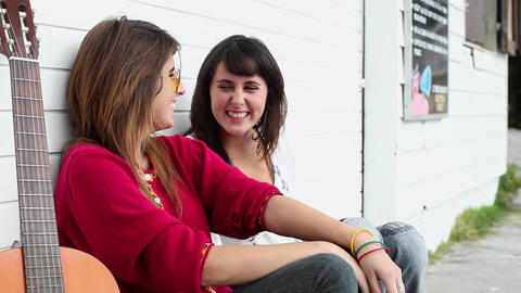 Girls watching young man walk past and laughing Stock Video Footage