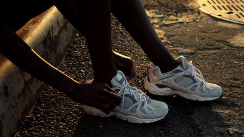 Runner tying her shoelaces Stock Video Footage