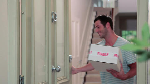 Delivery man knocking on front door, delivering parcel Footage