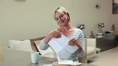 Mature woman opening and reading letter Stock Video Footage