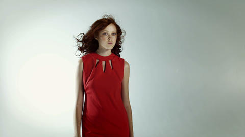 Young woman wearing red dress with windswept hair Stock Video Footage