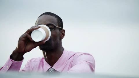 Businessman drinking from disposable cup Stock Video Footage