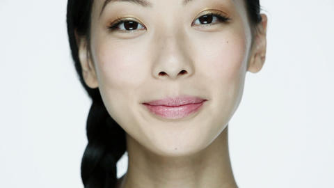 Young woman using cotton pad on face Stock Video Footage
