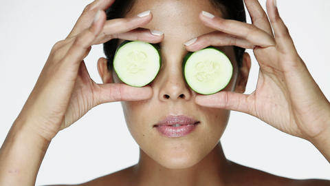 Woman holding cucumber slices over her eyes Stock Video Footage