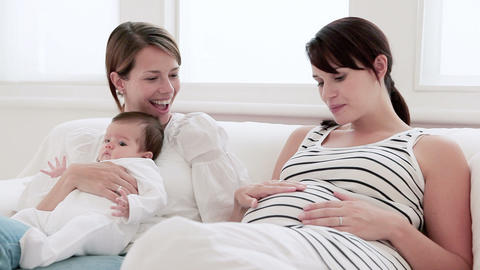Mother with baby girl and pregnant friend, film montage Stock Video Footage