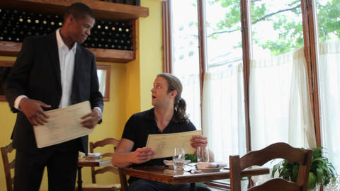 Waiter showing customer to table in restaurant Stock Video Footage
