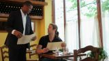 Waiter showing customer to table in restaurant Footage