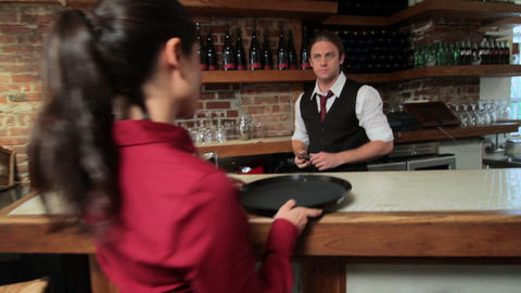 Bartender pouring drinks for waitress Stock Video Footage