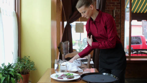 Waitress clearing table in restaurant Stock Video Footage