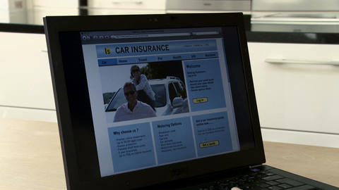 Young woman looking at car insurance on laptop, using the... Stock Video Footage