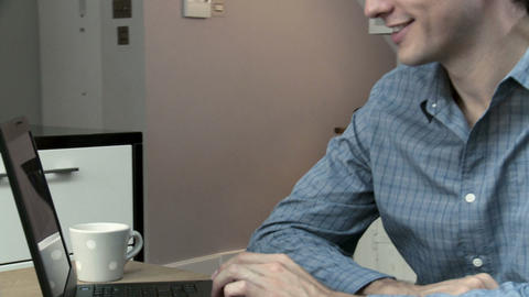 Man looking at insurance online using laptop Stock Video Footage