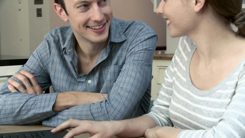 Young couple booking insurance online, woman using laptop Stock Video Footage