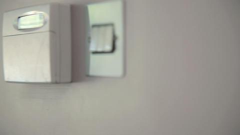 Woman setting burglar alarm, close up Stock Video Footage