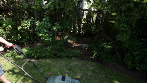 Boy mowing grass with lawnmower Stock Video Footage