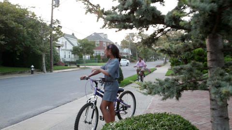Children playing outside on bikes Stock Video Footage