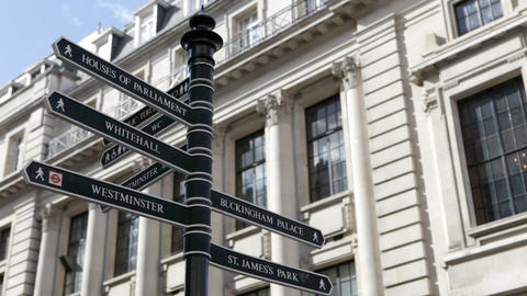 Camera tilts up to show London signpost Stock Video Footage