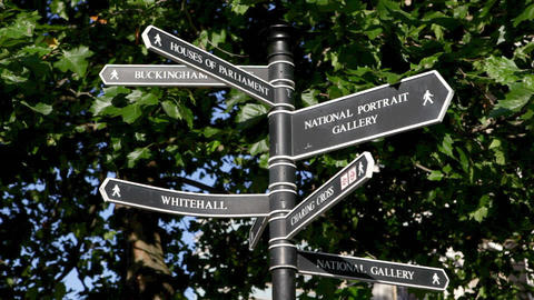 Camera pans from right to left to show London signpost Stock Video Footage